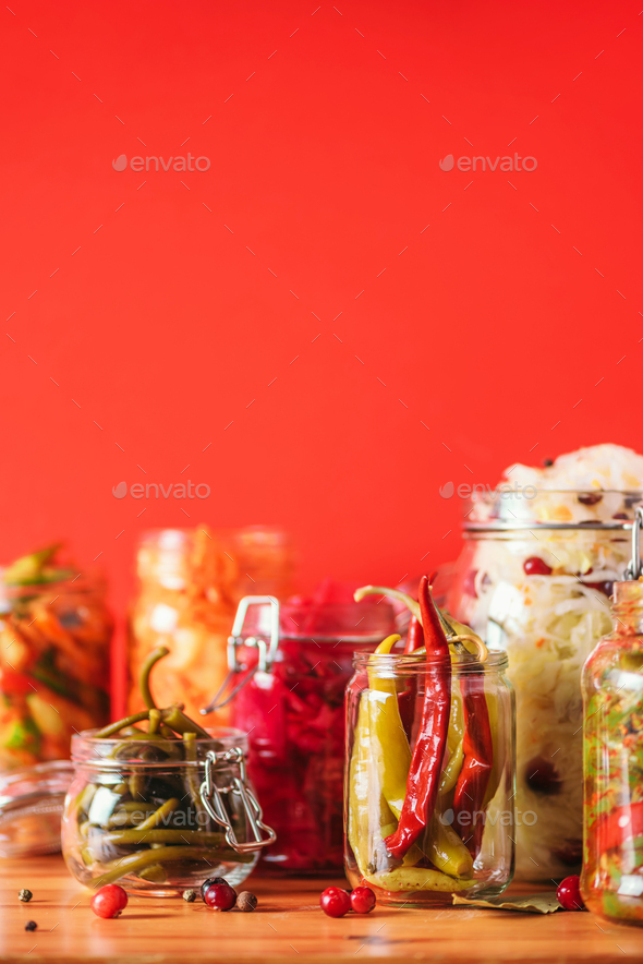 Assortment of various fermented and marinated food over wooden background, copy space. Fermented - Stock Photo - Images