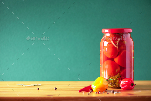 Preserved vegetables in glass jars on green background. Copy space. Healthy fermented food concept - Stock Photo - Images