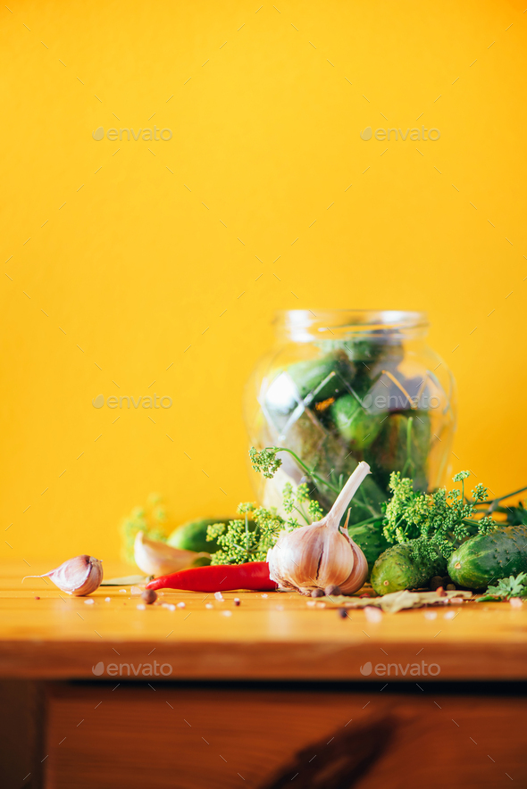 Ingredients, spices and herbs for canning cucumbers on yellow background. Copy space. Dill flowers - Stock Photo - Images