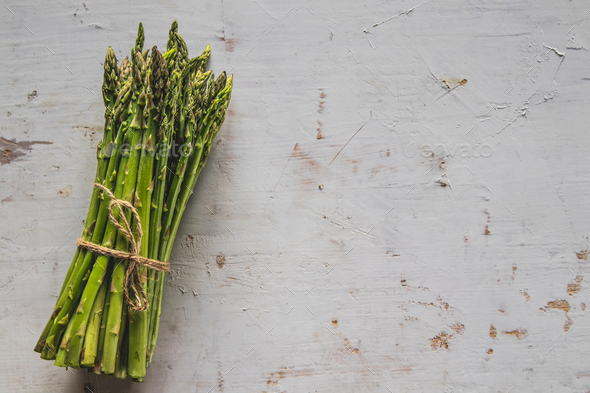 Fresh green spring asparagus on a wooden background. Asparagus season - Stock Photo - Images