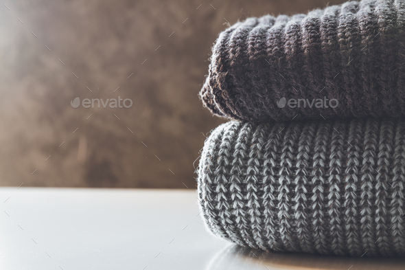 A stack of knitted sweaters ,the concept of warmth and comfort, hobby , background,closeup - Stock Photo - Images
