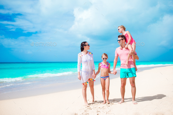 Happy beautiful family on white beach - Stock Photo - Images