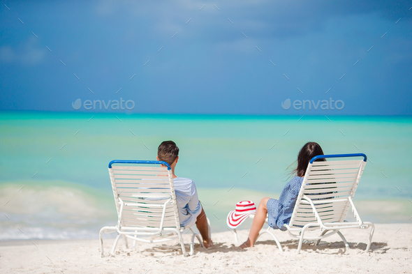 Couple relax on a tropical beach - Stock Photo - Images