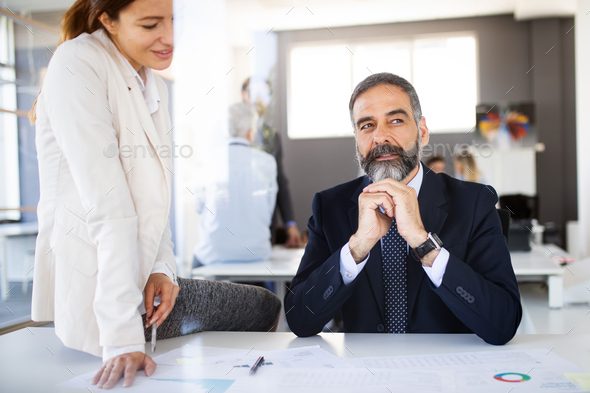 Business coworkers discussing new ideas and brainstorming in a modern office - Stock Photo - Images