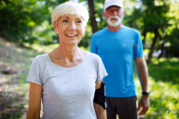 Fitness, sport, people, exercising and lifestyle concept - senior couple running - Stock Photo - Images