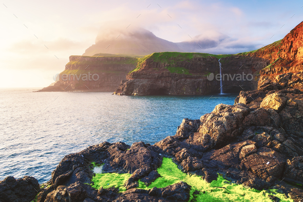 Mulafossur waterfall in Gasadalur, Vagar Island of the Faroe Islands - Stock Photo - Images