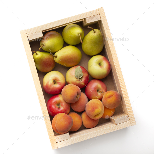 Fresh and organic garden fruits in eco wooden box on white - Stock Photo - Images