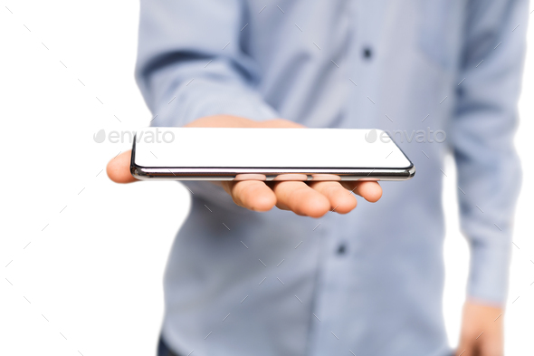 Man holding smartphone with blank white screen on open palm - Stock Photo - Images