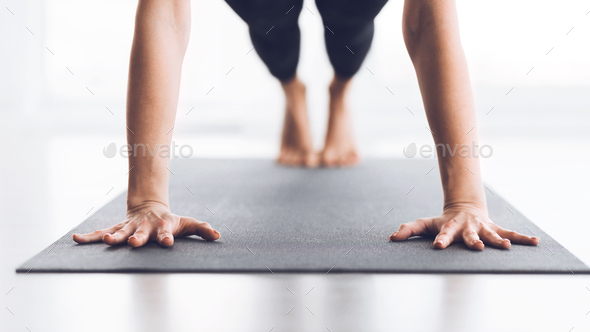 Slim woman practicing yoga in Plank pose, closeup - Stock Photo - Images