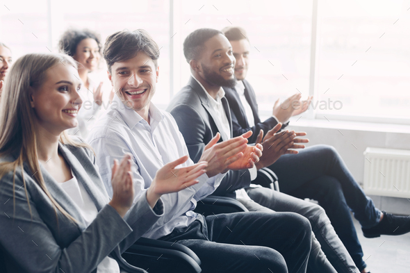Happy business people clapping hands during meeting conference - Stock Photo - Images