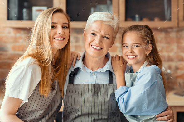 Portrait of mom and daughter hugging granny - Stock Photo - Images