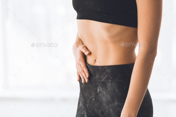 Young woman making exercise on belly vacuum - Stock Photo - Images