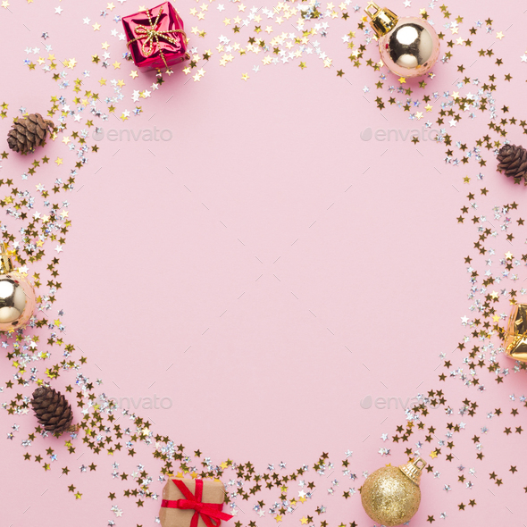 Round festive frame of decorations, gifts and confetti on pink - Stock Photo - Images