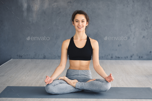 Yoga concept. Sportswoman sitting in lotus pose - Stock Photo - Images