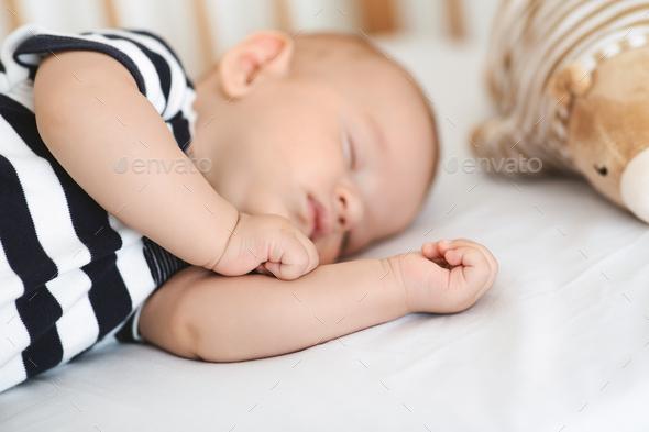 Closeup portrait of adorable sleeping newborn baby - Stock Photo - Images