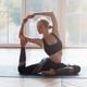 Beautiful female gymnast stretching before exercising in studio - PhotoDune Item for Sale