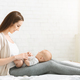 Millennial mom spending time with her newborn baby at home - PhotoDune Item for Sale