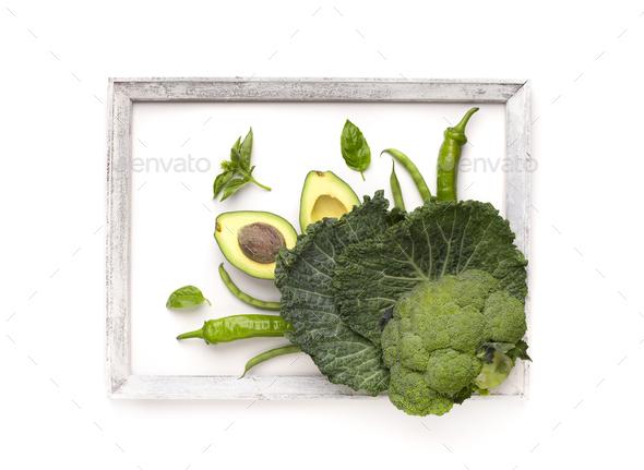 Green vegetables inside frame on white background - Stock Photo - Images