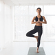 Finding right balance. Woman doing perfect tree pose - PhotoDune Item for Sale