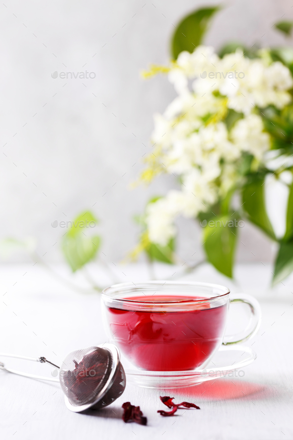 Cup of hibiscus tea, vertical shot - Stock Photo - Images