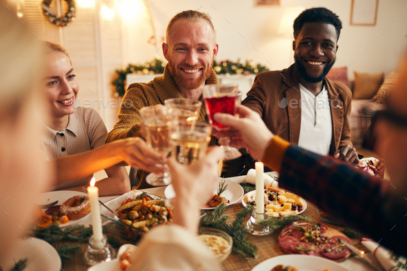 Adult People Raising Glasses at Dinner Party - Stock Photo - Images