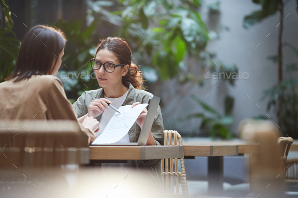 Female Entrepreneurs Discussing Business Project in Cafe - Stock Photo - Images
