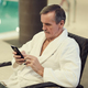 Modern Senior Man Using Smartphone in SPA - PhotoDune Item for Sale