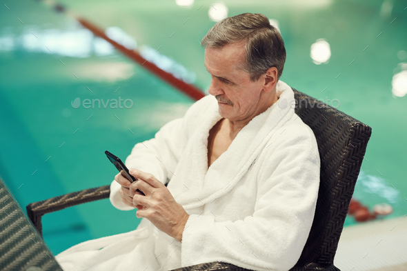 Senior Man Using Smartphone in SPA Resort - Stock Photo - Images