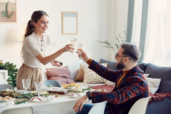 Elegant Couple Toasting at Christmas Party - Stock Photo - Images