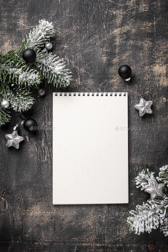 Christmas dark background with notebook - Stock Photo - Images