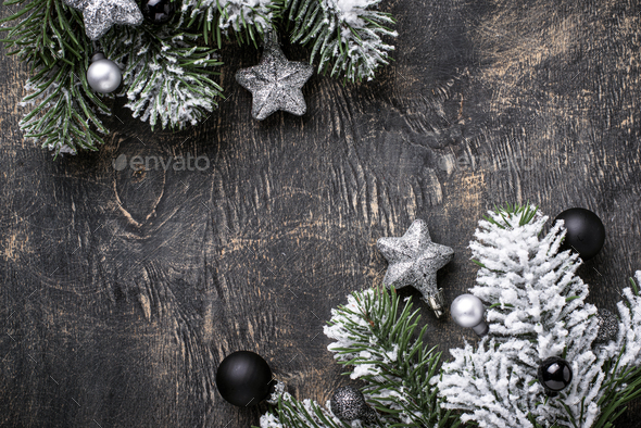 Christmas dark background with branch of tree - Stock Photo - Images