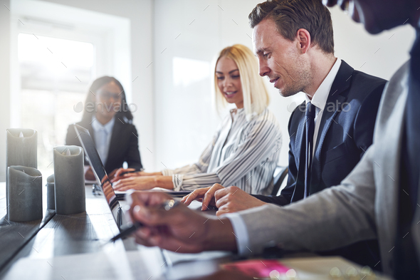 Diverse businesspeople having a meeting together in an office - Stock Photo - Images