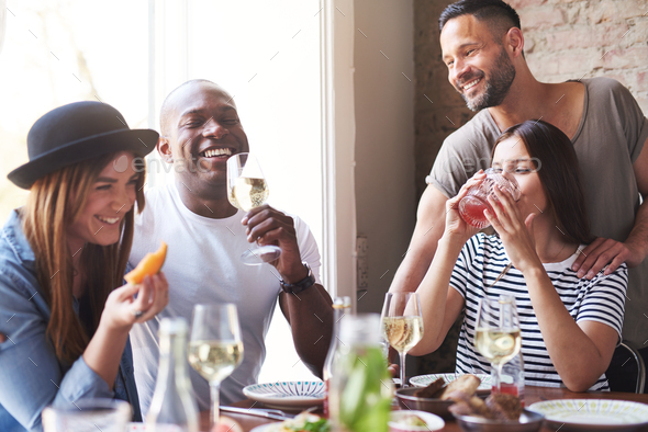 Group of adults celebrating with wine at lunch - Stock Photo - Images
