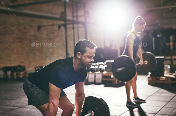 Strong people doing heavy workout with barbells - Stock Photo - Images