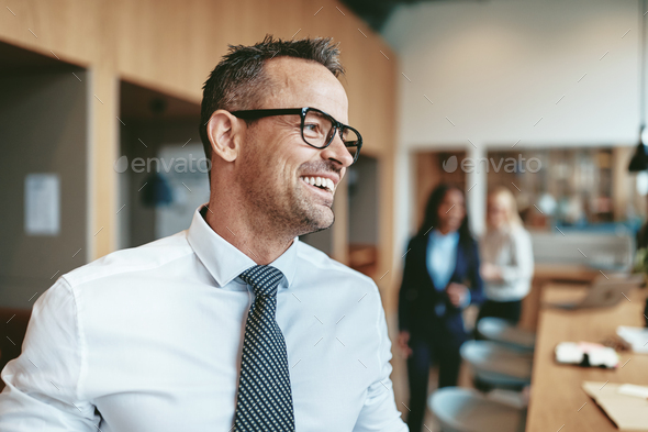Laughing mature businessman ready for a meeting with office colleagues - Stock Photo - Images