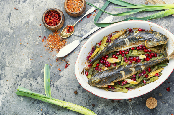 Baked fish with pomegranate - Stock Photo - Images