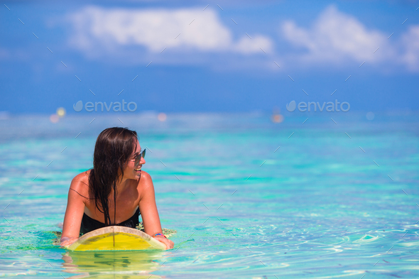 Beautiful surfer woman surfing during summer vacation - Stock Photo - Images