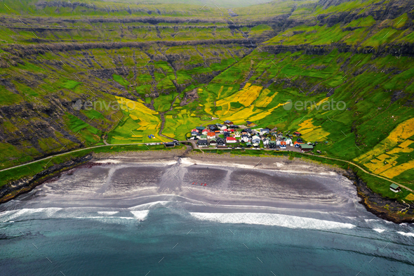 Aerial drone photo flying over Tjornuvik beach - Stock Photo - Images