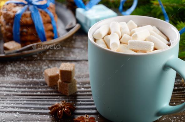 Christmas background of blue hot chocolate mug with marshmallows - Stock Photo - Images