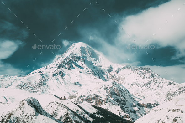 Stepantsminda, Gergeti, Georgia. Peak Of Mount Kazbek Covered With Snow. - Stock Photo - Images