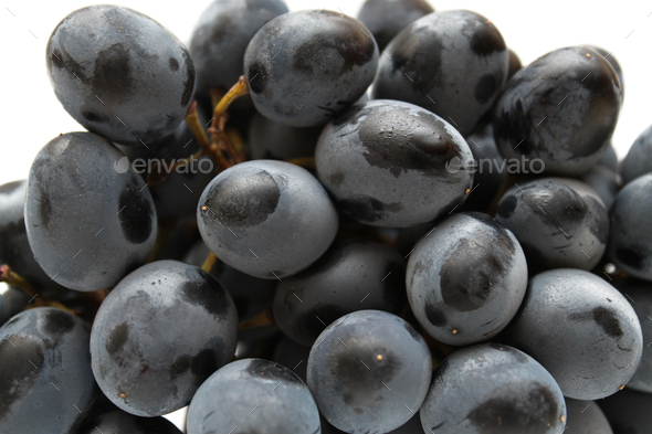 Closeup of tasty grapes cluster on white background - Stock Photo - Images