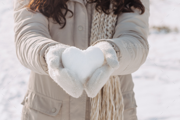 Snow Heart in Hands - Stock Photo - Images