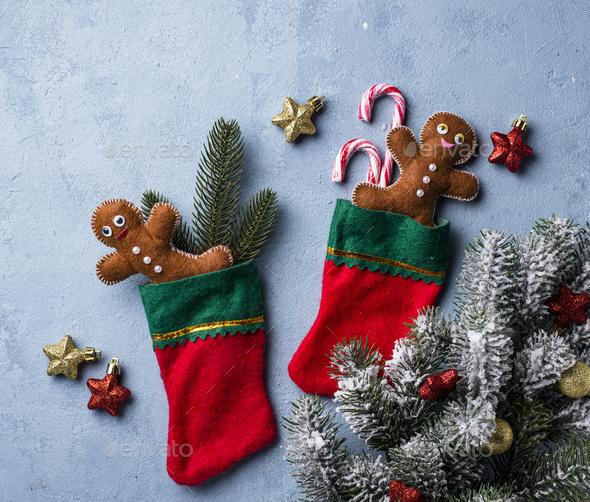 Felt gingerbread man in socks - Stock Photo - Images