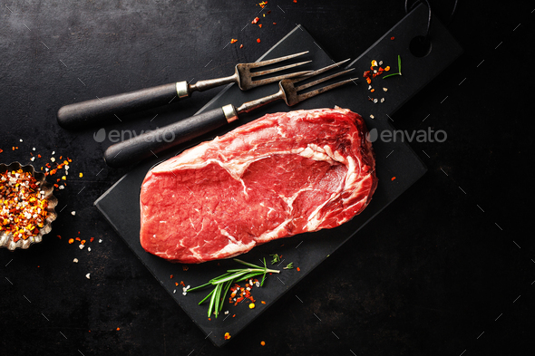 Raw beef steak on grill pan - Stock Photo - Images