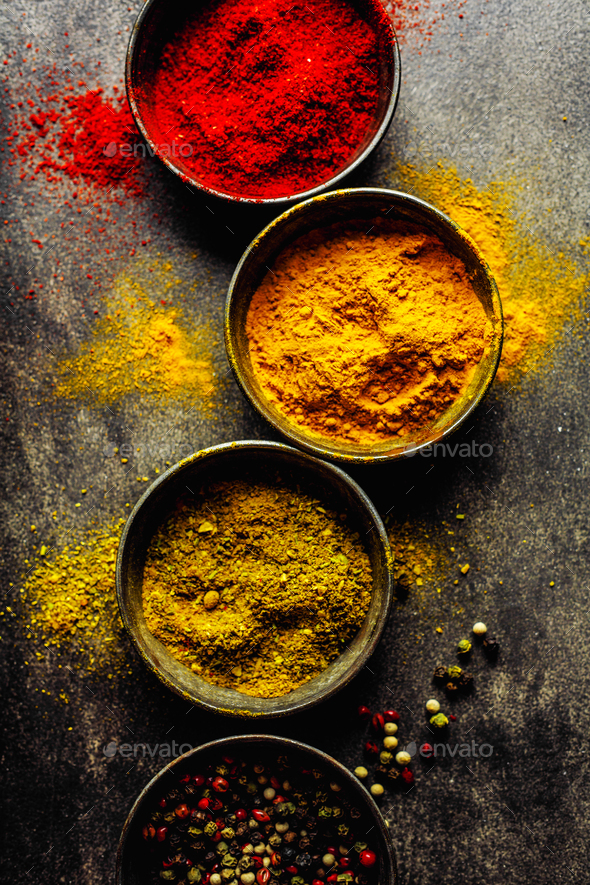 Colorful spices on dark background - Stock Photo - Images