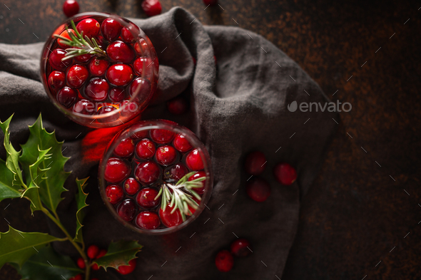 Mulled wine in glass with rosemary - Stock Photo - Images