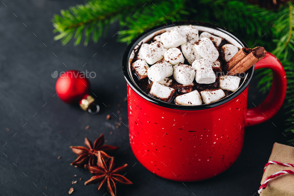 Christmas winter drink Hot Chocolate with marshmallow and cinnamon stick in red mug - Stock Photo - Images