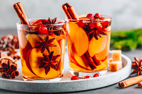 Apple cider mulled wine hot toddy or christmas punch in glass with fruits and spices - Stock Photo - Images