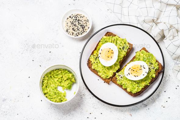 Avocado Sandwiches on white background - Stock Photo - Images