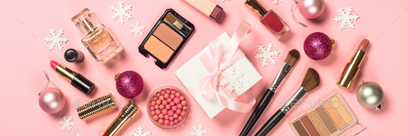Makeup professional cosmetics with christmas decor on pink - Stock Photo - Images